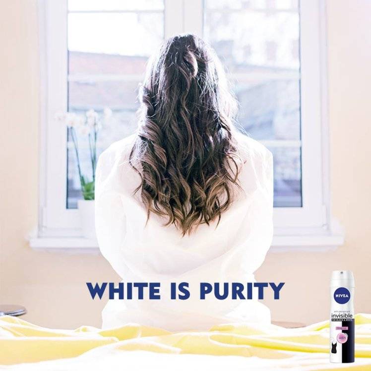 The official Nivea page on Facebook is putting out 'pro skin whitening' adverts with the slogan 'white is purity' Source: Facebook